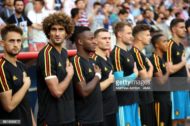 Adnan Januzaj Marouane Fellaini and Michy Batshuayi of Belgium stand for the anthems prior to the 2018 FIFA World Cup Russia group G match between...
