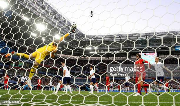 Adnan Januzaj of Belgium scores his team's first goal past Jordan Pickford of England during the 2018 FIFA World Cup Russia group G match between...