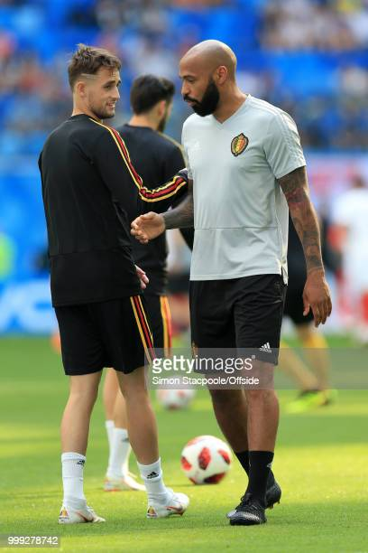 Adnan Januzaj of Belgium talks to assistant coach Thierry Henry before the 2018 FIFA World Cup Russia 3rd Place Playoff match between Belgium and...