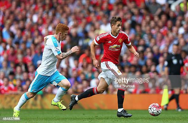 Adnan Januzaj of Manchester United and Jack Colback of Newcastle United compete for the ball during the Barclays Premier League match between...