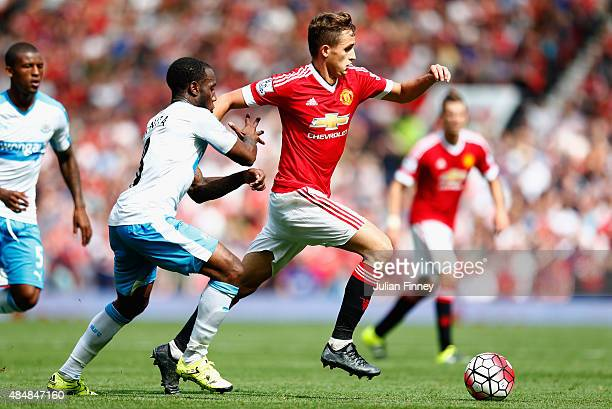 Adnan Januzaj of Manchester United battles with Vurnon Anita of Newcastle United during the Barclays Premier League match between Manchester United...