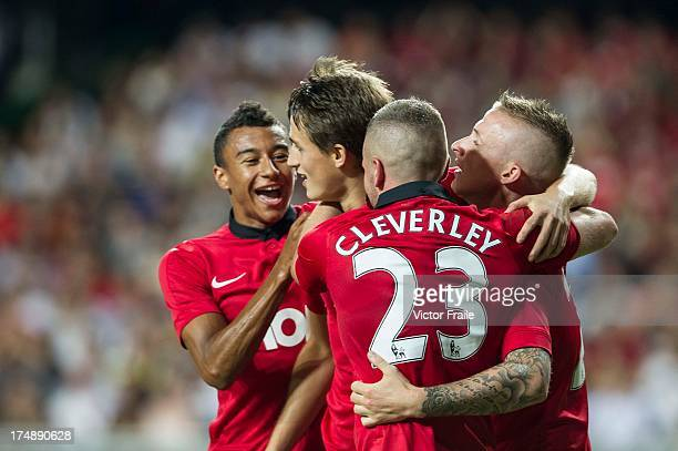 Adnan Januzaj of Manchester United celebrates his goal with teammates Tom Cleverley Alexander Buttner and Jesse Lingard during the international...