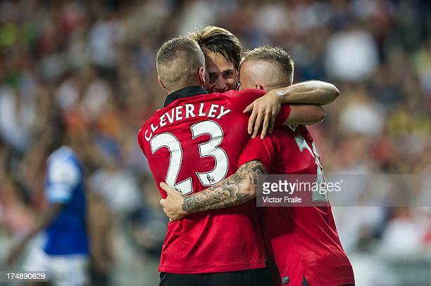 Adnan Januzaj of Manchester United celebrates his goal with teammates Tom Cleverley and Alexander Buttner during the international friendly match...