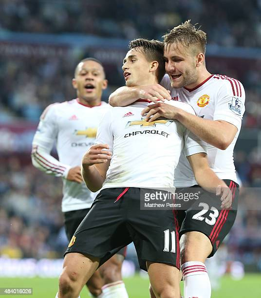Adnan Januzaj of Manchester United celebrates scoring the first goal with teammate Luke Shaw during the Barclays Premier League match between Aston...