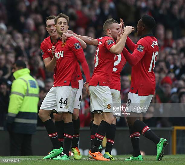 Adnan Januzaj of Manchester United celebrates scoring their second goal during the Barclays Premier League match between Manchester United and West...