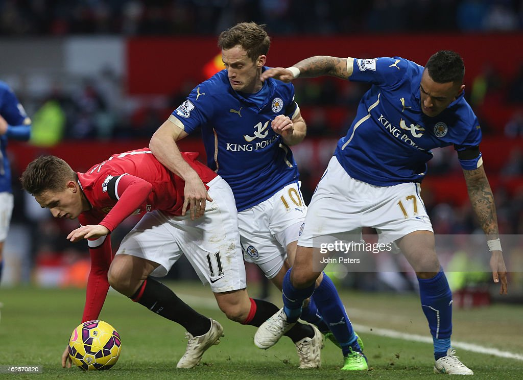 Adnan Januzaj of Manchester United in action with Andy King and Danny Simpson of Leicester City during the Barclays Premier League match between Manchester United and Leicester City at Old Trafford on January 31, 2015 Manchester, England.