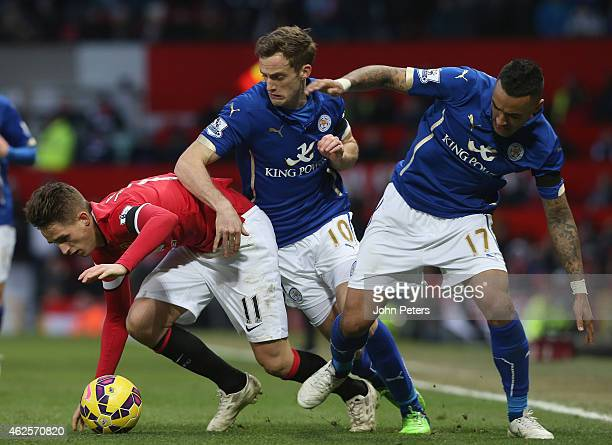 Adnan Januzaj of Manchester United in action with Andy King and Danny Simpson of Leicester City during the Barclays Premier League match between...