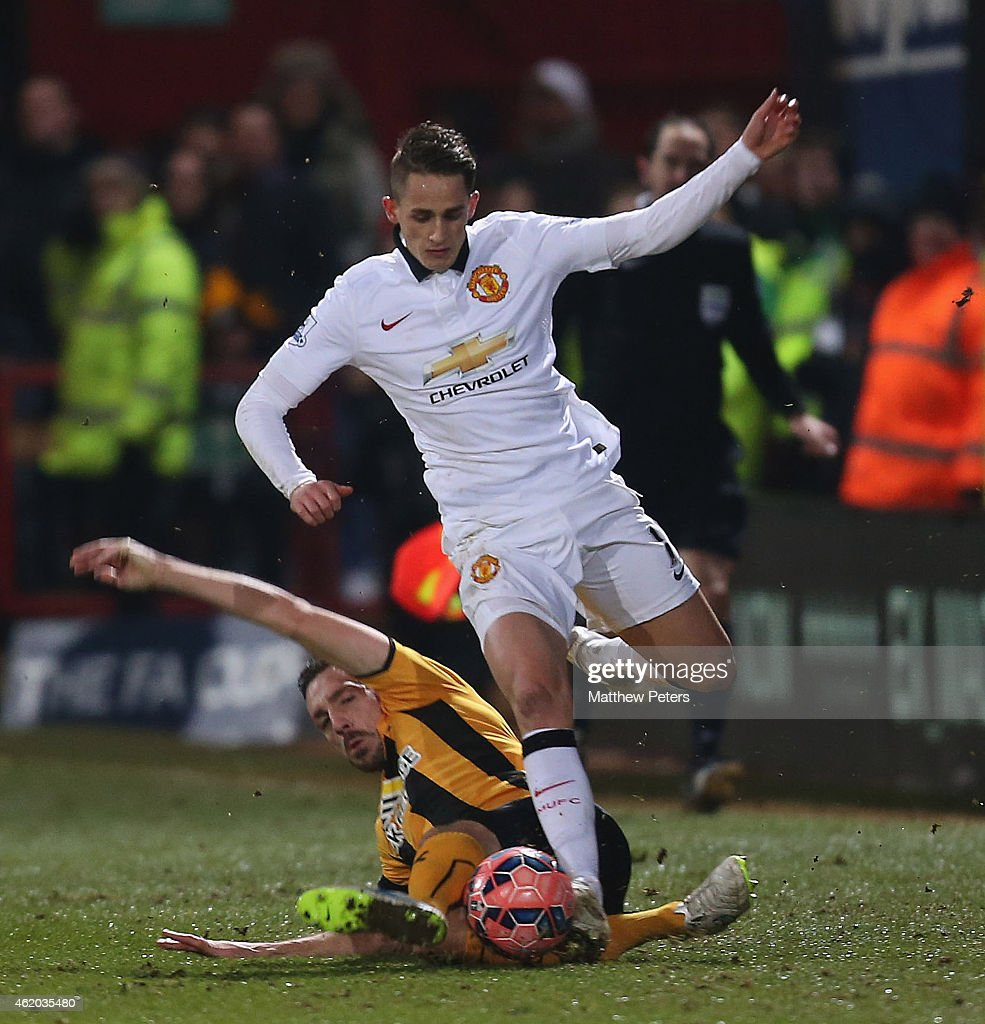 Adnan Januzaj of Manchester United in action with Greg Taylor of Cambridge United during the FA Cup Fourth Round match between Cambridge United and Manchester United at The R Costings Abbey Stadium on January 23, 2015 in Cambridge, England.