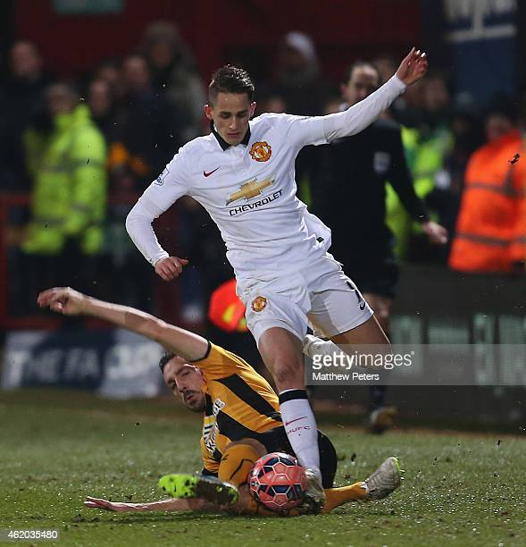 Adnan Januzaj of Manchester United in action with Greg Taylor of Cambridge United during the FA Cup Fourth Round match between Cambridge United and...
