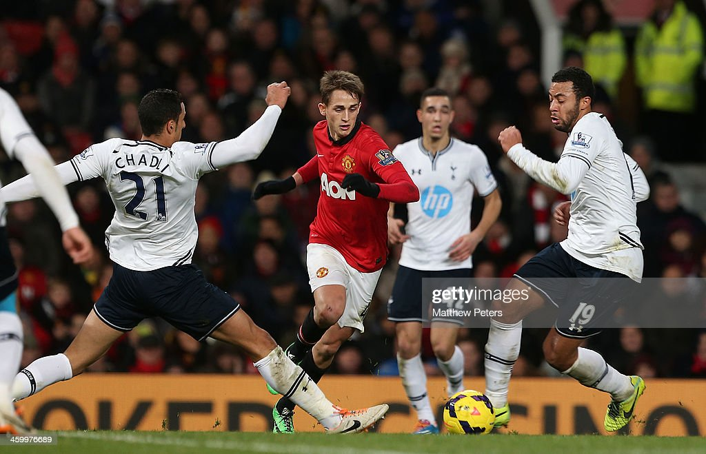 Adnan Januzaj of Manchester United in action with Vlad Chiriches and Mousa Dembele of Tottenham Hotspur during the Barclays Premier League match between Manchester United and Tottenham Hospur at Old Trafford on January 1, 2014 in Manchester, England.