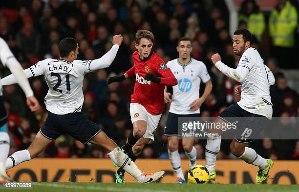 Adnan Januzaj of Manchester United in action with Vlad Chiriches and Mousa Dembele of Tottenham Hotspur during the Barclays Premier League match...