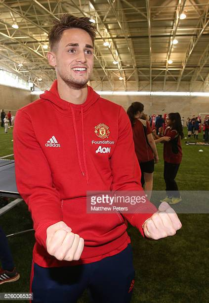 Adnan Januzaj of Manchester United meets with children from a local school as part of the MU Foundation Players Day at Aon Training Complex on April...
