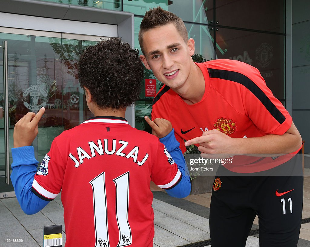 Adnan Januzaj of Manchester United Presents A Shirt To A Young Fan : News Photo