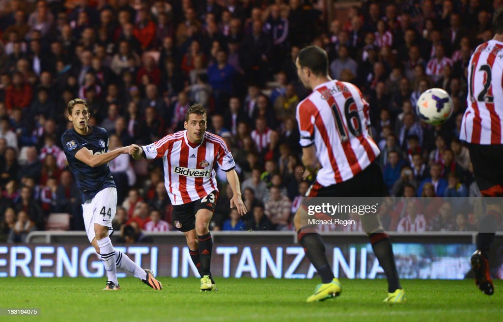 Adnan Januzaj of Manchester United scores his team's second goal during the Barclays Premier League match between Sunderland and Manchester United at the Stadium of Light on October 5, 2013 in Sunderland, England.