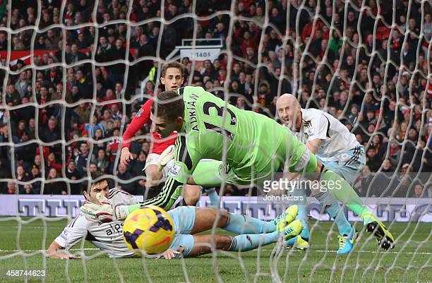 Adnan Januzaj of Manchester United scores their second goal during the Barclays Premier League match between Manchester United and West Ham United at...