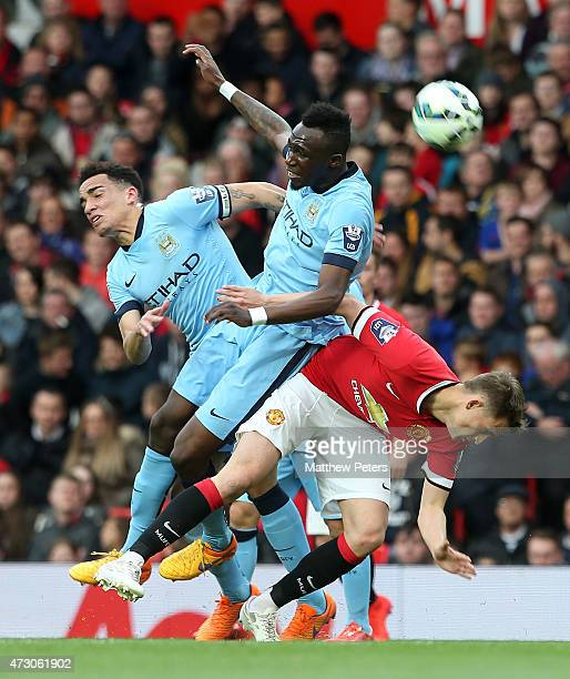 Adnan Januzaj of Manchester United U21s in action with Kean Bryan and Angelino of Manchester City U21s during the Barclays U21 Premier League match...