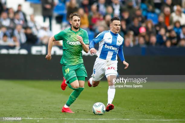 Adnan Januzaj of Real Sociedad and Roque Mesa of Leganes in action during the Spanish League La Liga football match played between CD Leganes and...
