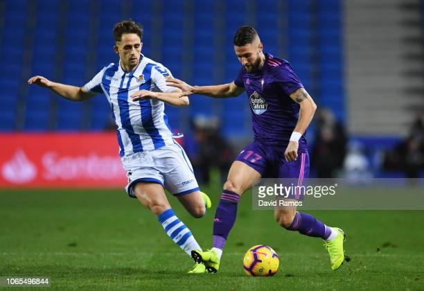Adnan Januzaj of Real Sociedad battles for possession with David Junca of Celta Vigo during the La Liga match between Real Sociedad and RC Celta de...