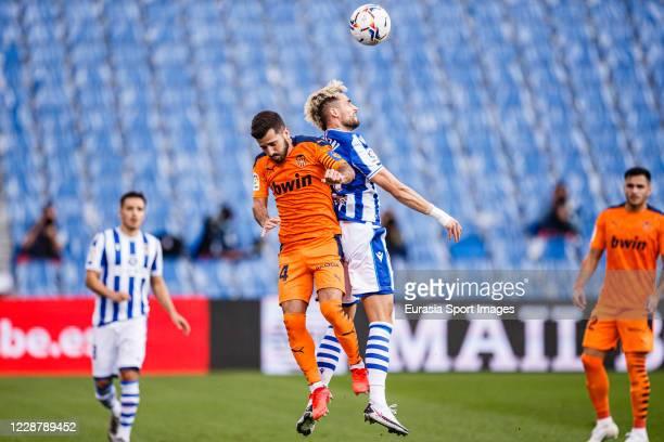 Adnan Januzaj of Real Sociedad battles for the ball with Jose Gaya of Valencia CF during the La Liga Santander match between Real Sociedad and...