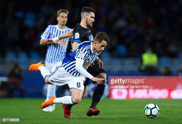 Adnan Januzaj of Real Sociedad being competes for the ball with Alfonso Pedraza of Deportivo Alaves during the La Liga match between Real Sociedad...