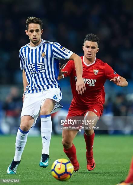Adnan Januzaj of Real Sociedad being followed by Sebastien Corchia of Sevilla FC during the La Liga match between Real Sociedad and Sevilla at...