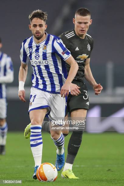 Adnan Januzaj of Real Sociedad breaks forwards with the ball as Scott McTominay of Manchester United pursues during the UEFA Europa League Round of...