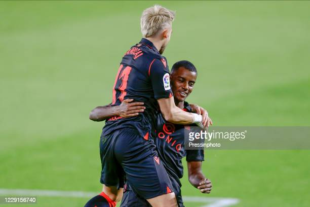 Adnan Januzaj of Real Sociedad celebrates after scoring the 03 with his teammate Alexander Isak during the La Liga match between Real Betis and Real...