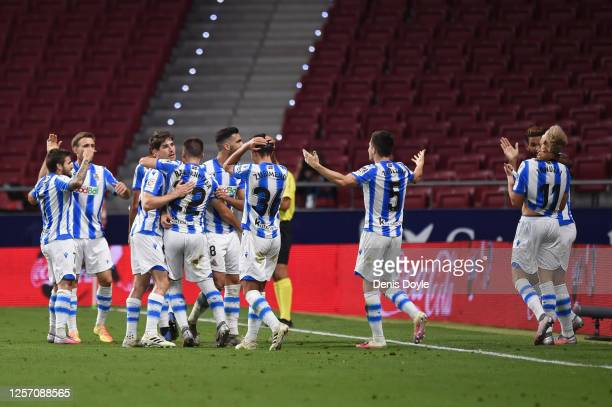 Adnan Januzaj of Real Sociedad celebrates his team's first goal during the Liga match between Club Atletico de Madrid and Real Sociedad at Wanda...