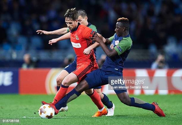 Adnan Januzaj of Real Sociedad competes for the ball with Amadou Haidara of FC Red Bull Salzburg during UEFA Europa League Round of 32 match between...