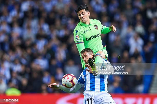 Adnan Januzaj of Real Sociedad competes for the ball with Jose Manuel Rodriguez of Levante UD during the La Liga match between Real Sociedad and...