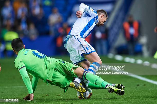 Adnan Januzaj of Real Sociedad competes for the ball with Jose Manuel Rodriguez 'Chema' of Levante UD during the La Liga match between Real Sociedad...
