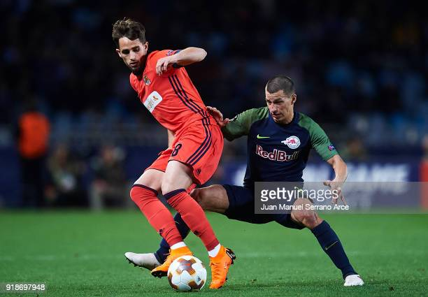 Adnan Januzaj of Real Sociedad competes for the ball with Stefan Lainer of FC Red Bull Salzburg during UEFA Europa League Round of 32 match between...