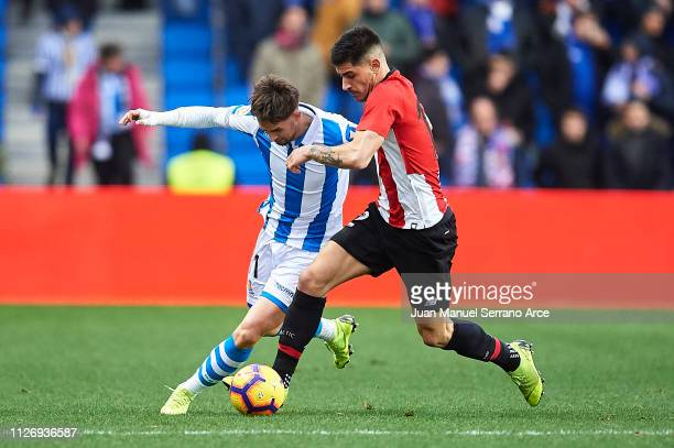 Adnan Januzaj of Real Sociedad competes for the ball with Yuri Berchiche of Athletic Club during the La Liga match between Real Sociedad and Athletic...