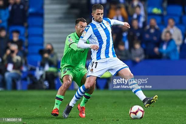 Adnan Januzaj of Real Sociedad controls the ball under pressure of Antonio Luna of Levante UD during the La Liga match between Real Sociedad and...
