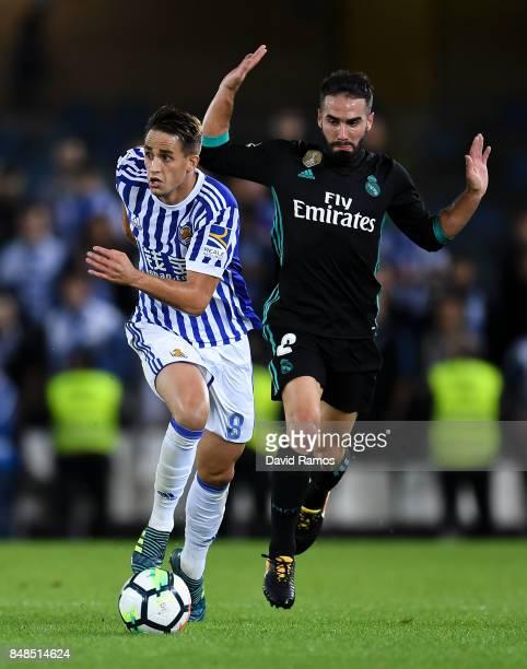Adnan Januzaj of Real Sociedad de Futbol competes for the ball with Daniel Carvajal of Real Madrid CF during the La Liga match between Real Sociedad...