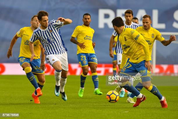 Adnan Januzaj of Real Sociedad duels for the ball with D Castellano and Bigas of U D Las Palmas during the Spanish league football match between Real...