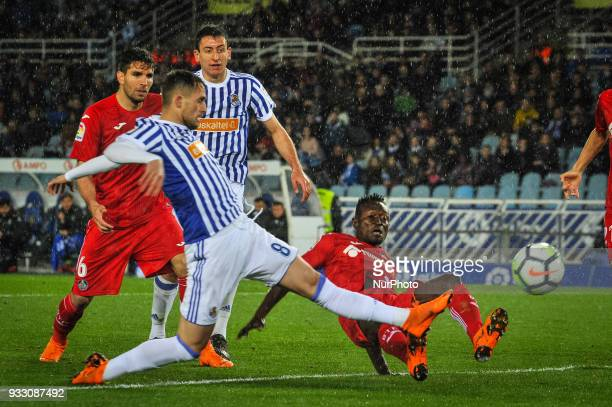 Adnan Januzaj of Real Sociedad duels for the ball with Djene of Getafe during the Spanish league football match between Real Sociedad and Getafe at...