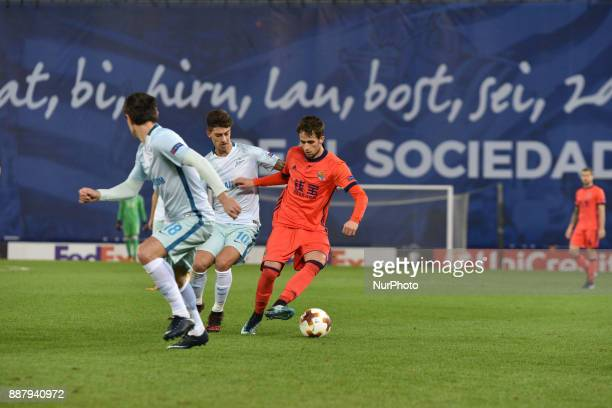 Adnan Januzaj of Real Sociedad duels for the ball with Emiliano Rigoni of Zenit during the UEFA Europa League Group L football match between Real...