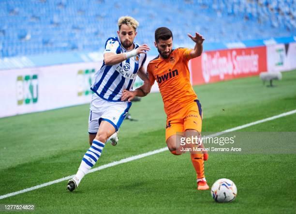 Adnan Januzaj of Real Sociedad duels for the ball with Jose Gaya of Valencia CF during the La Liga Santander match between Real Sociedad and Valencia...