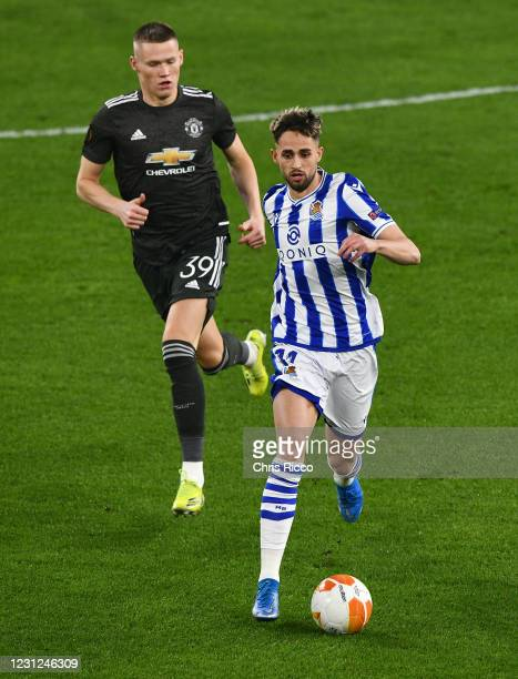 Adnan Januzaj of Real Sociedad evades challenge from Scott McTominay of Manchester United during the UEFA Europa League Round of 32 match between...