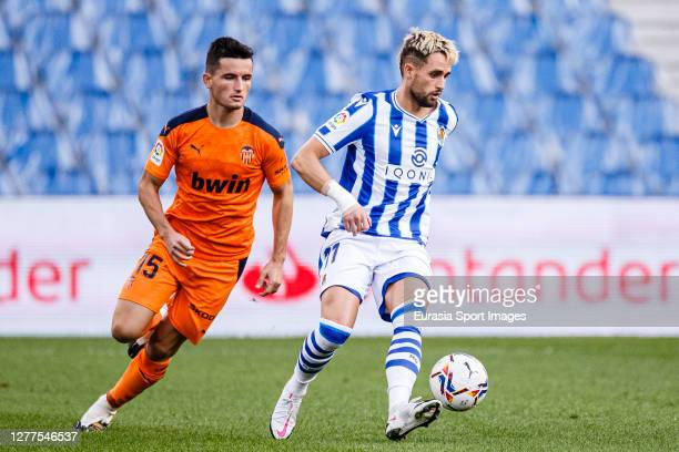 Adnan Januzaj of Real Sociedad is chased by Hugo Guillamón of Valencia CF during the La Liga Santander match between Real Sociedad and Valencia CF at...