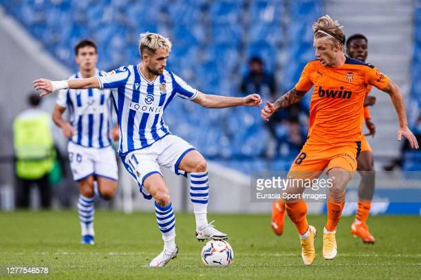 Adnan Januzaj of Real Sociedad plays against Daniel Wass of Valencia CF during the La Liga Santander match between Real Sociedad and Valencia CF at...