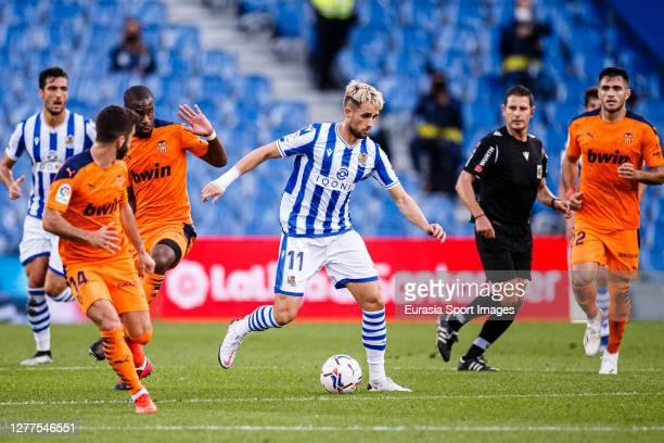 Adnan Januzaj of Real Sociedad plays against Geoffrey Kondogbia of Valencia during the La Liga Santander match between Real Sociedad and Valencia CF...