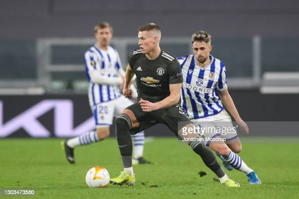 Adnan Januzaj of Real Sociedad pursues Scott McTominay of Manchester United during the UEFA Europa League Round of 32 match between Real Sociedad and...