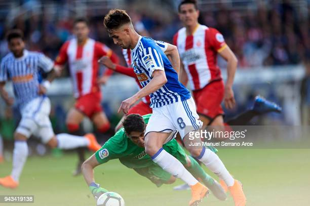 Adnan Januzaj of Real Sociedad scoring his team's second goal during the La Liga match between Real Sociedad de Futbol and Girona FC at Estadio...