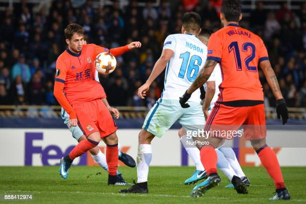 Adnan Januzaj of Real Sociedad vies with Christian Noboa of Zenit during the UEFA Europa League Group L football match between Real Sociedad and...