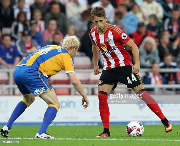 Adnan Januzaj of Sunderland attacks the Shrews defence during the EFL Cup second round match between Sunderland AFC and Shrewsbury Town FC at Stadium...