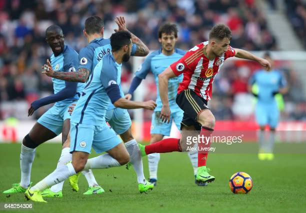 Adnan Januzaj of Sunderland attempts to escape the Manchester City defence during the Premier League match between Sunderland and Manchester City at...