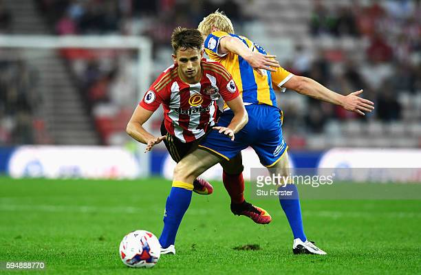 Adnan Januzaj of Sunderland is fouled by Ryan McGivern of Shrewsbury Town during the EFL Cup second round match between Sunderland and Shrewsbury...