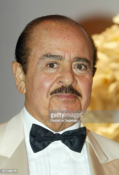 Adnan Khashoggi arrives at the Monte Carlo Red Cross Ball 2004 held at the Salle des Etoiles of the Monaco Sporting Club August 6 2004 in Monte Carlo...